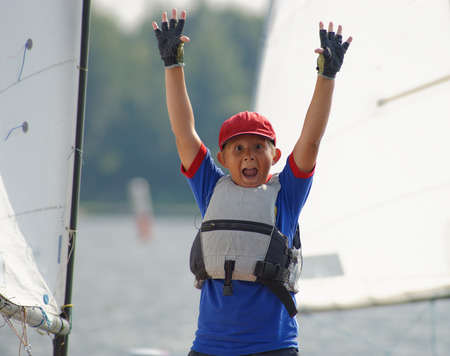 yachtsman: Young yachtsman joy over the victory. Stock Photo
