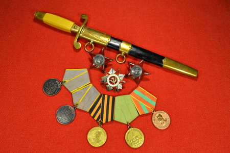 Still life with an officers dagger and military orders and medals of the USSR. Editöryel
