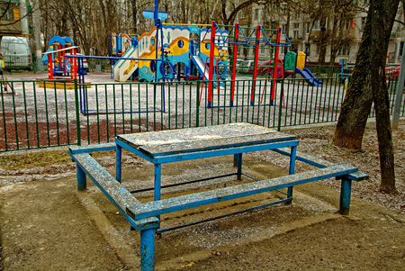 The playground in Moscow, snow spring morning
