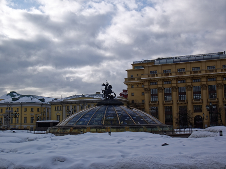 the glass dome at the Manege square on the background of the cloudy sky, Moscow