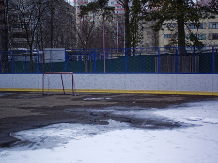 snow melts on the hockey field , Moscow