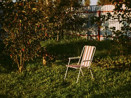 folding chair in the garden in summer, Russia
