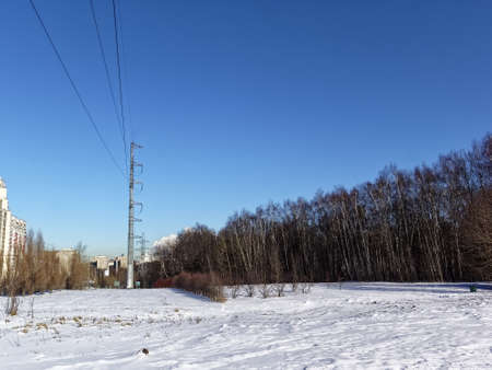power line masts in winter on a clear day, Moscow