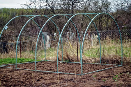 greenhouse arcs without film in the garden, in the spring