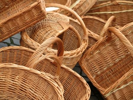 Many empty wicker woven baskets photo