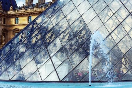 louvre pyramid: PARIS , JUNE 06  The Louvre Pyramid on June, 06, 2012 in Paris, France