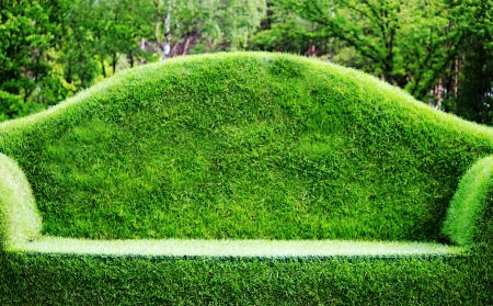 midst: Grass Sofa in midst the forest Stock Photo