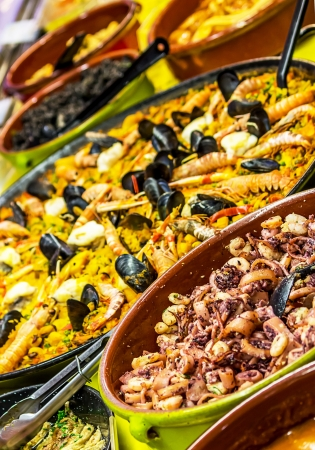 marisco: Paella and Calamari on display Stock Photo