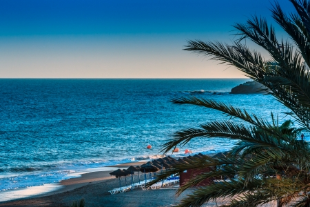 beach landscape: Beach landscape with sun loungers in the evening Stock Photo