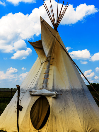 tepee: Indian Tepee Tent and cloudy blue sky Stock Photo