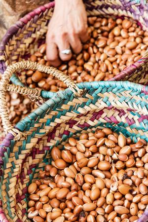 Moroccan Argan oil production- Dry Argan nuts in baskets Archivio Fotografico