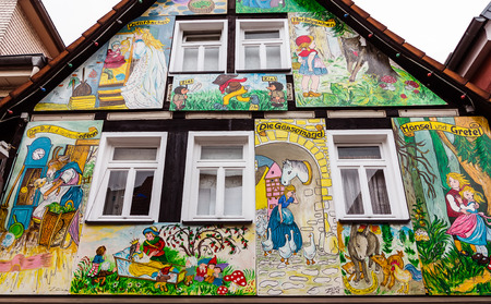 Painted house in the fairy tale town Steinau on the road, with scenes from the brothers Jacob and Wilhelm Grimm fairy tales, Germany