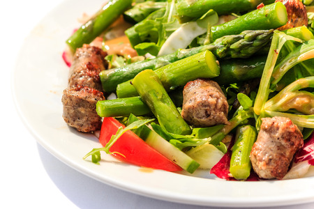 Green salad with asparagus and Italian Sausage