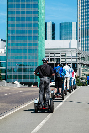 a two wheeled vehicle: Tourists exploring Frankfurt with Segway