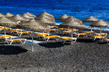 black pebbles: Kamari Beach of Santorini covered with black pebbles, Greece Iceland Stock Photo