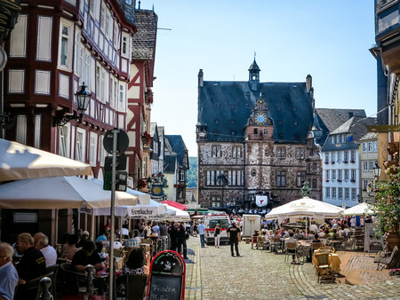 half timbered: Marburg, GERMANY-July 07, 2013: Market square with historical Town Hall in University City of Marburg, Germany Editorial