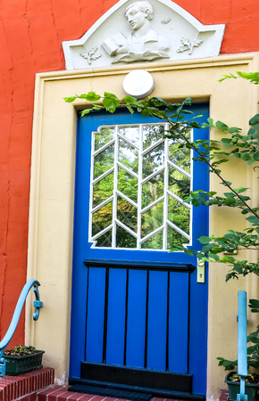reside: House with a blue door in Potsdam, Germany