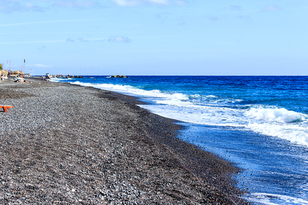 black pebbles: Kamari beach covered with black pebbles in Santorini, Greek Island