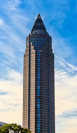 FRANKFURT AM MAIN, GERMANY-JUNE 06, 2015: The Messeturm 63-storey Trade Fair Tower designed by Helmut Jahn in a postmodern architectural style, oft called The pencil pencil due to its shape.