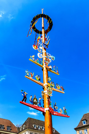 maypole: Traditional Franconian maypole on the market square of Wuerzburg, Bavaria, Germany Stock Photo