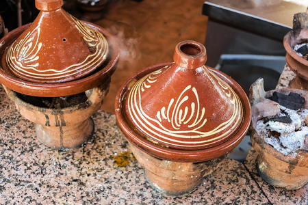 moroccan cuisine: Traditional Moroccan cuisine - preparing couscous on charcoal fire