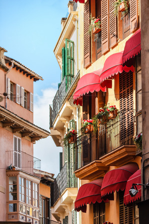 spanish houses: Picturesque row of houses with typical Spanish balconies near the marketplace in Palma de Mallorca, Spanish, Balearic Islands, Mediterranean, Spain