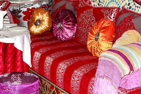 seating area: Colorful Moroccan sofa with cushions