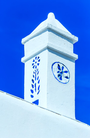 cycladic: Typical whitewashed rooftop with blue pattern traditional Cycladic architecture, Greece