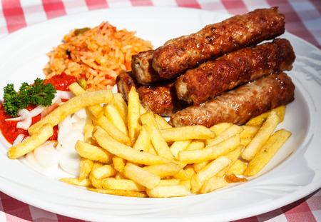 Cevapcici with rice and French Fritters