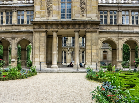 Paris- The Musà © e Carnavalet. Patio with beautiful ornate gardens. The museum which opened in 1880 and is dedicated to the history of Paris, from its origins to the present day Editorial