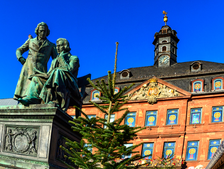 Brothers Grimm in front of the town hall in Hanau looking down at the Christmas market, Germany Stock Photo