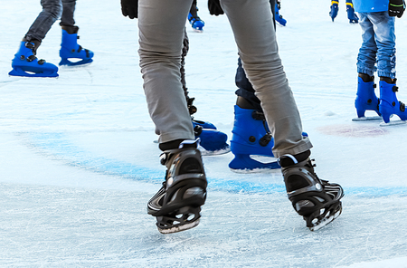 iceskating: Winter activities � � fun at the outdoor ice-skating rink Stock Photo