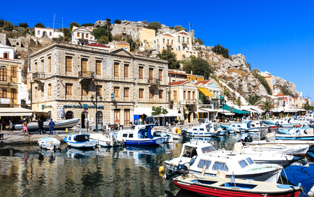 SYMI, GREECE-September 27, 2016: Picturesque harbor with colorful houses of Symi town, Dodecanese, Greek Iceland
