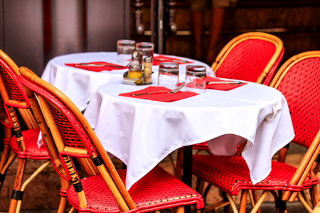 Stock Photo   Table Laid For Lunch In A Parisian Cafe With Red Wicker Chairs