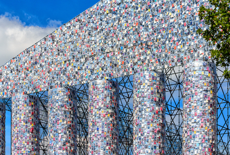 """KASSEL, GERMANY-JUNE 14, 2017: documenta art 14 - Monumental replica of the Acropolis temple -The steel framework columns of the """"Parthenon of books"""" covered with books of books."""
