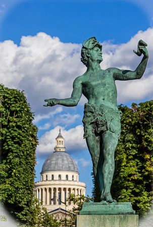 The LActeur Grec statue by Baron Bourgeois inside the Luxembourg Gardens. It was designed to depict a young actor, with a manuscript in his hand, practicing his role in a play