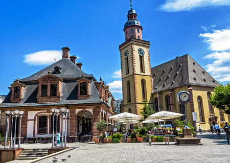 FRANKFURT, GERMANY-JULY 21, 2017: The historic caf? ? Hauptwache (popular meeting place since its opening over 100 years ago) and St. Katharine church in the middle of the city