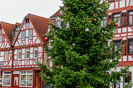 Christmas tree in front of old german half-timbered houses in a small village
