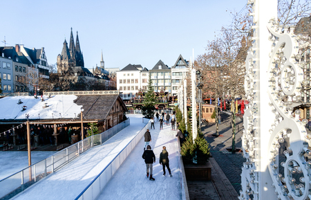 Cologne, Germany - Winter Time in the Old Town. In this fairy-tale atmosphere, a unique skating rink fits into the Heumarkt (Hay Market). Banco de Imagens