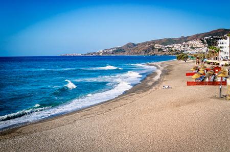 The beach of Nerja (Playa el Chucho), tourist resort Malaga region, Costa del Sol, Andalucia, Spain