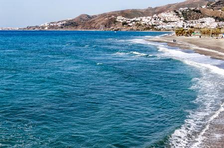 The sandy beach of Nerja, attractive tourist resort Malaga region, Costa del Sol, Andalucia, Spain