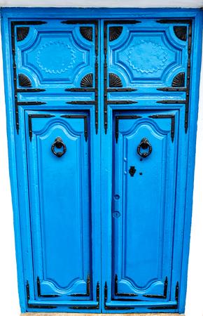 A blue wooden door with black ornaments in Frigillana white village. Andalusia, Costa del Sol, Spain
