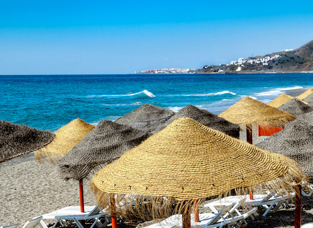 Beautiful sandy beach of Nerja, attractive tourist resort Malaga region, Costa del Sol, Andalucia, Spain
