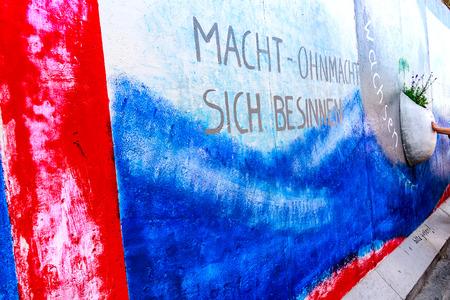 BERLIN, GERMANY - July 27, 2018: Graffiti art on original section of Berlin Wall at East Side Gallery in Friedrichshain.