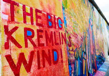 BERLIN, GERMANY - July 27, 2018: Wonderful street art and graffiti on a stretch of Berlin wall.