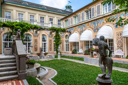 """BAD KISSINGEN, GERMANY - AUGUST 23, 2018: Neo-baroque style small landscaped courtyard called """"Schmuckhof� (jewelry yard) of the Kurhaus Bad Kissingen in Bavaria. Editoriali"""