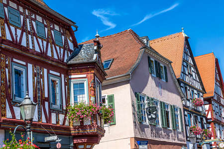SELIGENSTADT, GERMANY-AUGUST 19, 2020: Picturesque half-timbered historic houses in Seligenstadt. The town lies on the banks of the Main and was of great importance in Carolingian times.