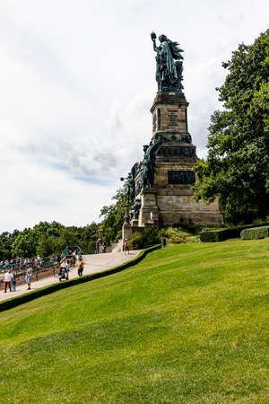 The Statue Germania, or The Niederwalddenkmal is a monument in the Niederwald Landscape Park, it overlooks the valley of the Rhine. Near Rudesheim, Germany