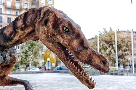 tyrannosaur: toy tyrannosaur against the street