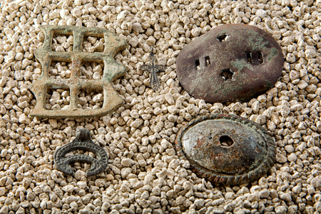 pagan: artifacts on the white river sand. Jewellery horse rides, pagan talisman and the Christian cross. Stock Photo